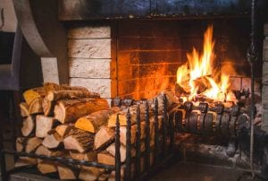 open fire with logs stacked in front of it | kiln dried hardwood logs for sale